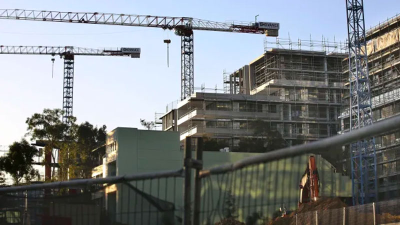 Falling approvals and construction of apartments reflect curbs on immigration.