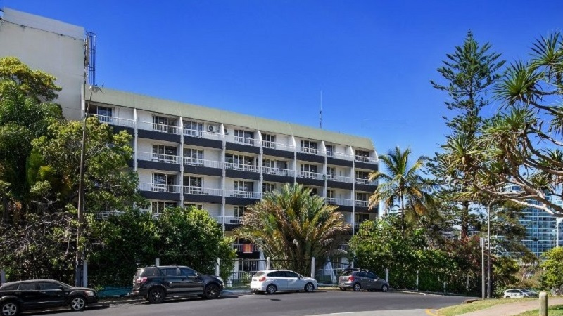 The aging Greenmount Beach House is located on a hillside in Coolangatta overlooking the beach.