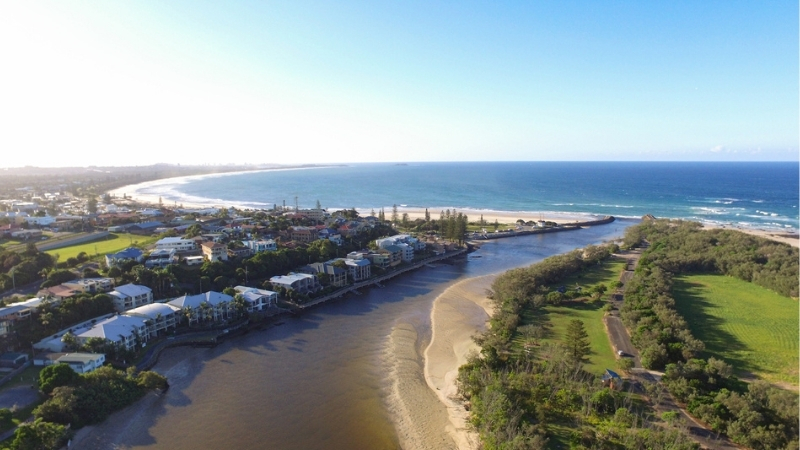 The main waterway through Kingscliff NSW leading out to the beach goes alongside a series of apartments.