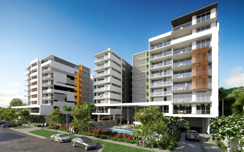 Two seven-storey residential towers in Darwin with grey and white finishes and an ground level pool.