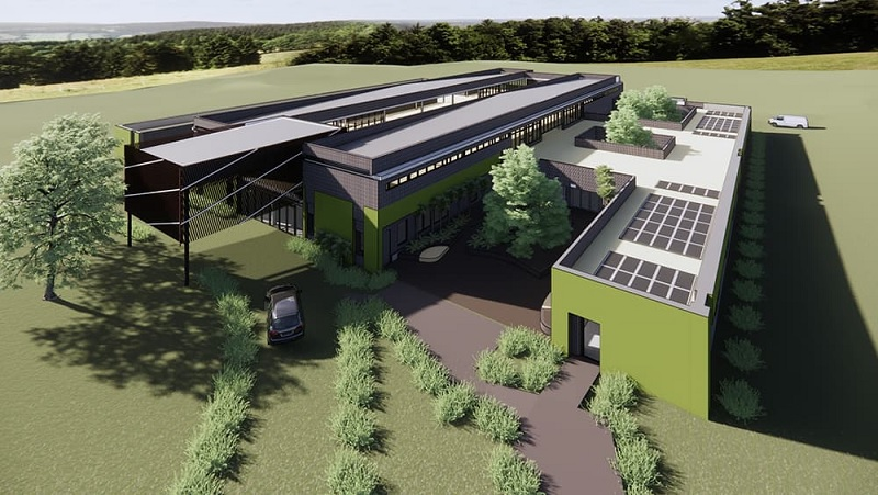 An artists impression of a satellite hospital planned for Queensland. It has three wings and is located in a rural area.