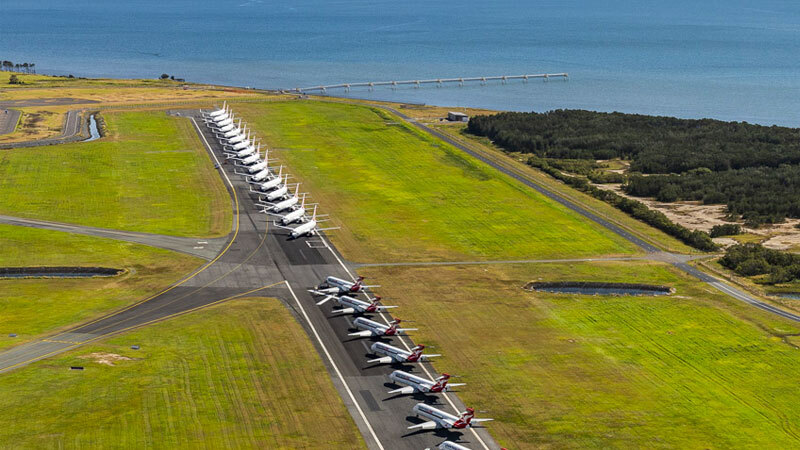 Aerial view of parked planes on Brisbane Airport's Runway 14/32, the decommissioning of which it brought forward to create additional parking space - free of charge - for grounded aircraft.