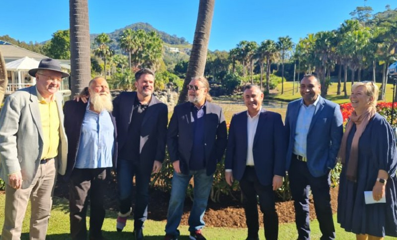 Seven people standing in a row at a tropical development site in NSW including Peter Montgomery, Keith Rodger and Russell Crowe.