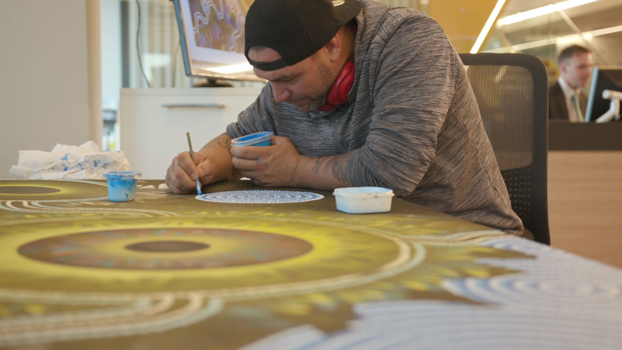 This year Suncorp launched its first Reconciliation Action Plan to support social and economic prosperity for Aboriginal and Torres Strait Islander peoples. Artist Jeremy Donovan working on a piece for Suncorp to mark the launch.