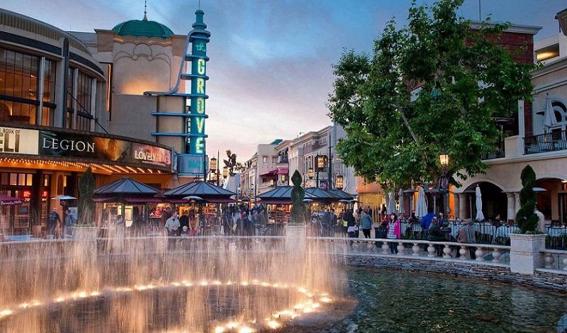 A large water fountain in the middle of the street in the iconic The Grove shopping and entertainment precinct in Los Angeles,