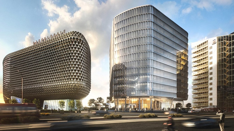 The SAHMRI building, a spikey round health facility and the Australian Bragg Centre a tall smooth med-tech facility in Adelaide.