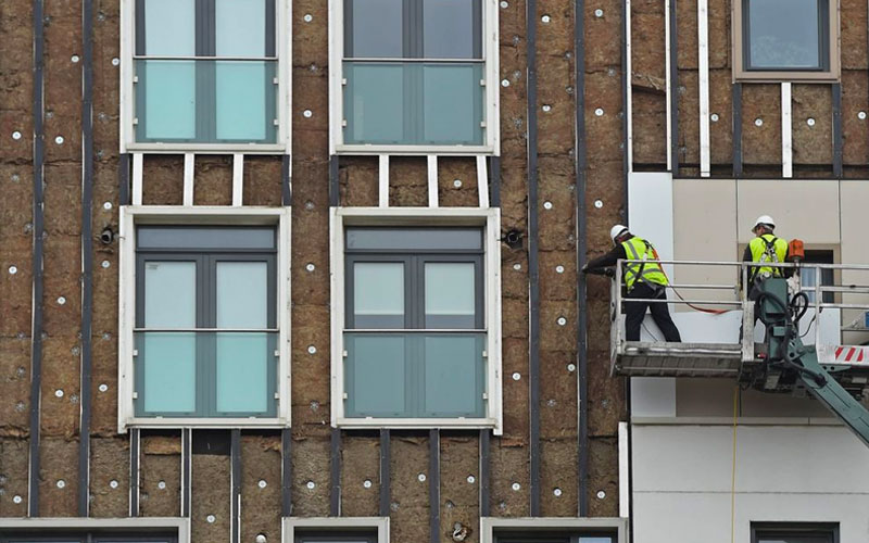 ▲ Aluminium composite cladding being removed from a 'high risk' building.