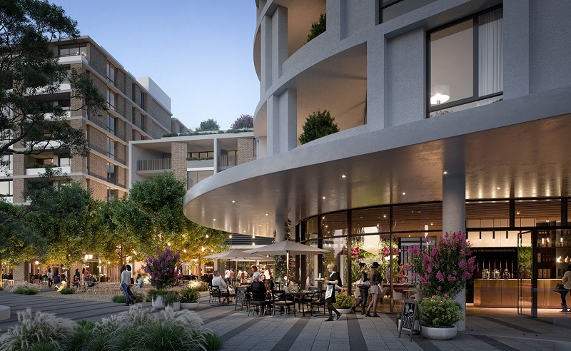 A cafe and open space within the Tallawong Village development has rounded facades and trees.