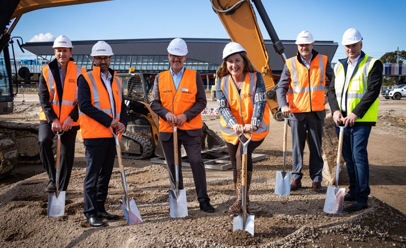 Image of six people in high-vis holding shovels at a building site in Mernda north of Melbourne.