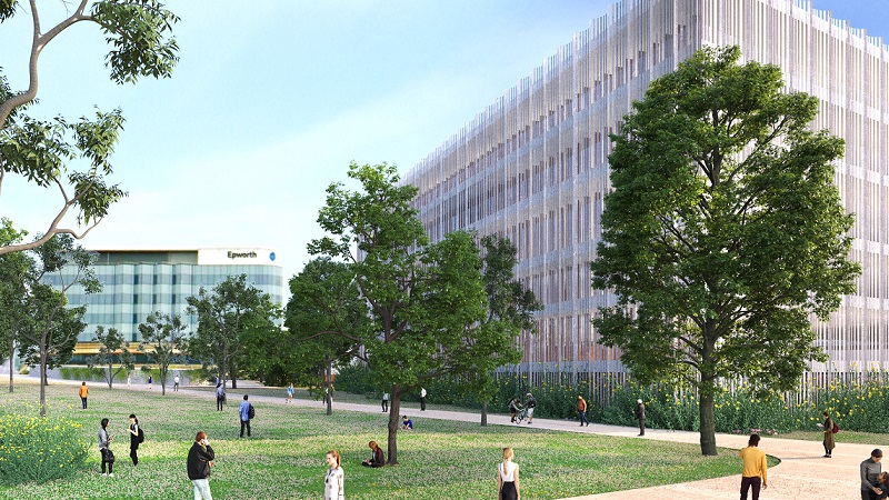 Render of proposed healthcare buildings in Geelong that are about six-storeys and surrounded by landscaped lawns with leafy trees.
