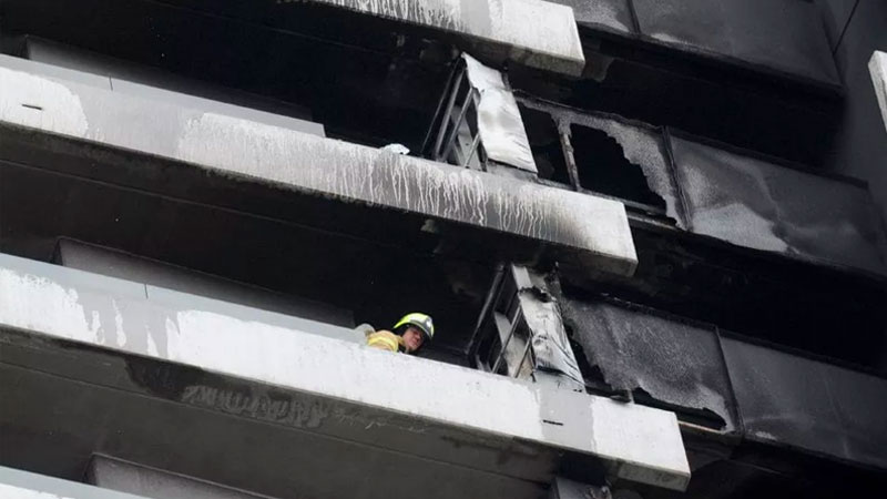 ▲ Fire crews at an apartment tower fire in Spencer Street in February. Image:  Andrew Henshaw