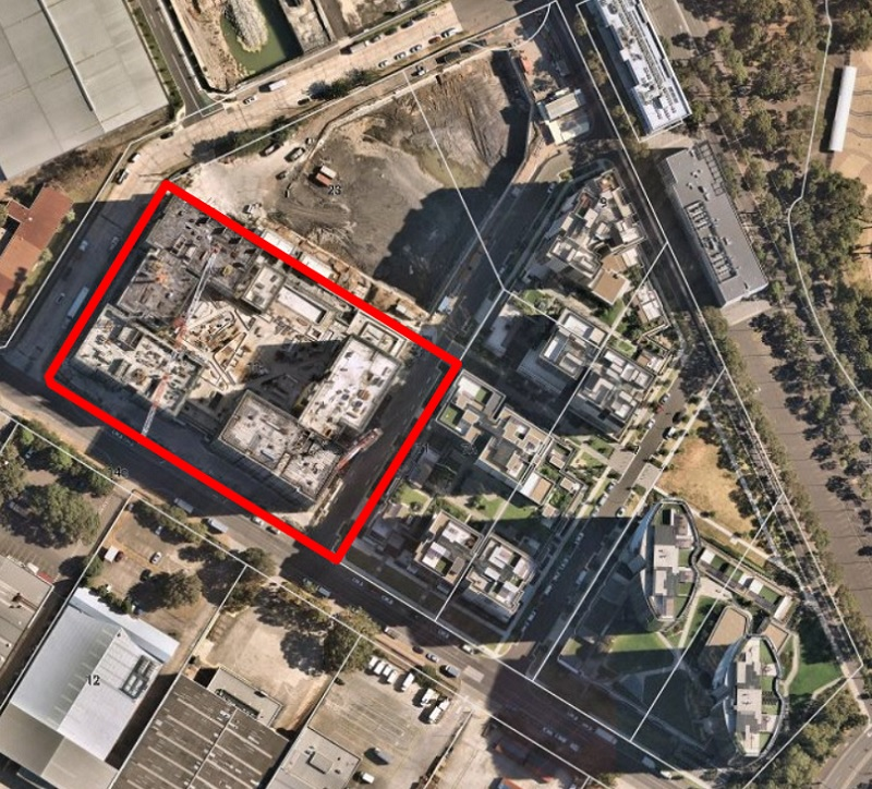 An aerial image of Meriton's triangular Carter Street Precinct development with an under construction site identified by a red outline.