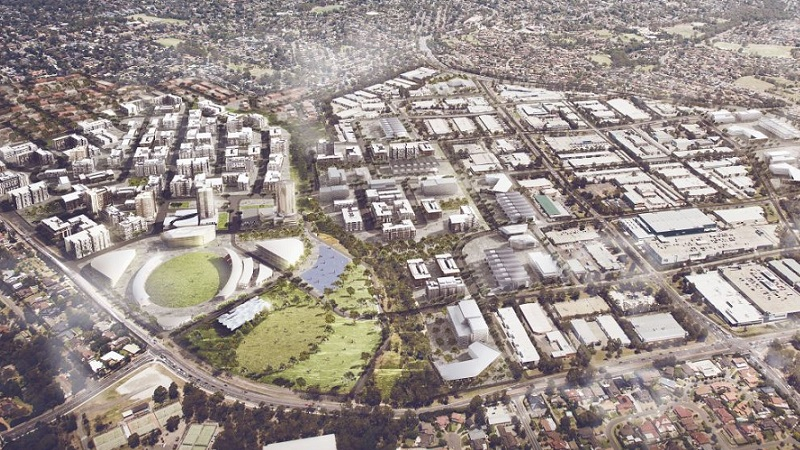 Aerial of an artists impression of a showground surrounded by mid-rise apartment blocks.