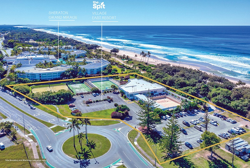Drone image of a a development site with tennis courts, a swimming pool and carparks next to a resort on The Spit, Gold Coast.
